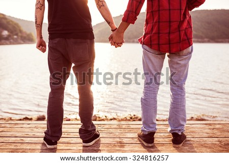 Image of gay couple holding hands - stock photo