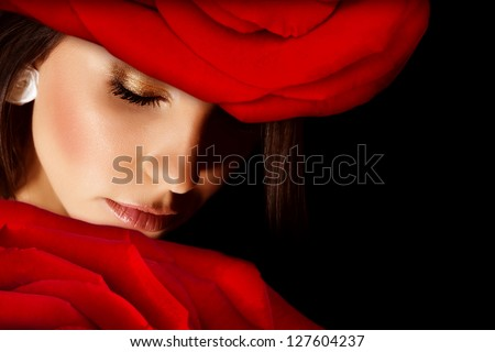 Image of glamorous woman wearing stylish floral hat, closeup portrait of beautiful arabic female with red rose on head isolated on black background, closed eyes, Valentine day, beauty salon - stock photo