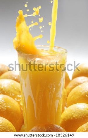 Image of glass of orange juice with fruits near by - stock photo