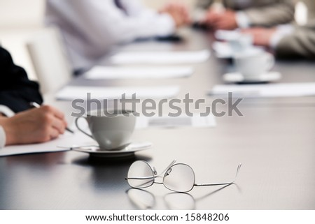 Image of  glasses placed on the table during a seminar - stock photo