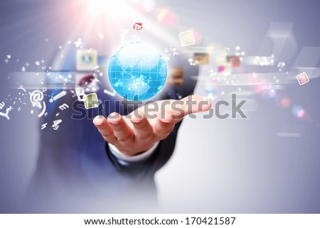 Image of globe on palm of businessman. Media technologies - stock photo
