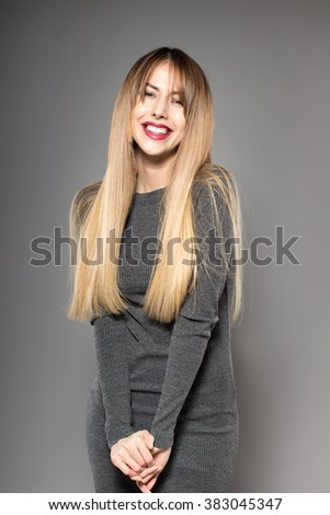Image of gorgeous young caucasian attractive sexy business woman or secretary wearing long grey dress - stock photo