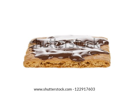 Image of Graham crackers with chocolate syrup lying on a white surface - stock photo