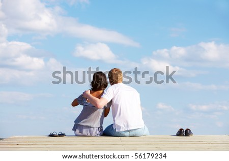 Image of guy embracing his girlfriend while enjoying hot summer day - stock photo