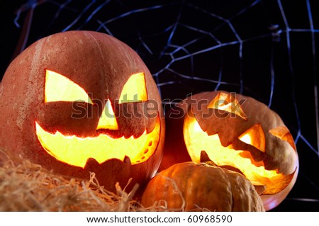 Image of Halloween jack o'lanterns with cobweb on background - stock photo