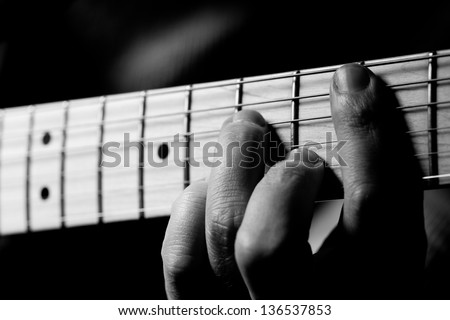 Image Of Hand And Guitar. - stock photo