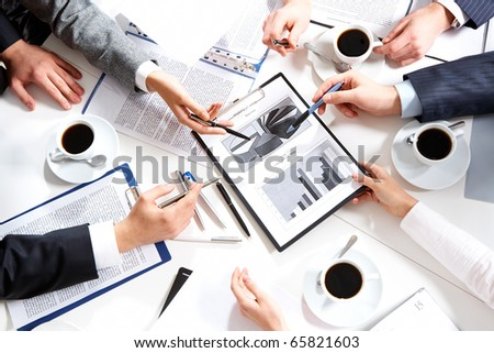 Image of hands of working businesspeople at meeting - stock photo