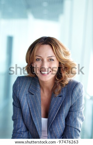 Image of happy businesswoman looking at camera - stock photo