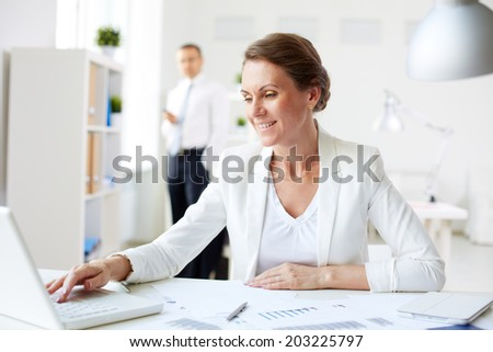 Image of happy businesswoman networking at workplace - stock photo