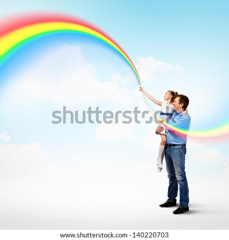 Image of happy father holding on hands daughter ad rainbow - stock photo