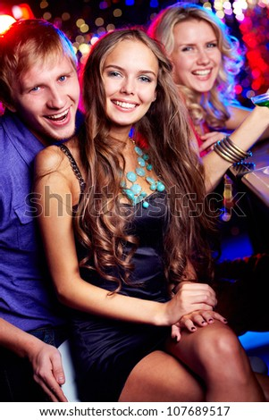 Image of happy friends looking at camera in bar - stock photo