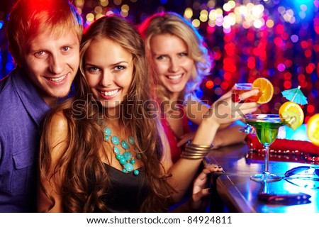 Image of happy girl looking at camera with her friends near by - stock photo