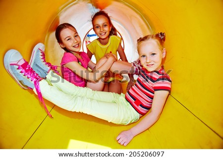 Image of happy little girls spending leisure together  - stock photo