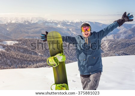 Image of happy male snowboarder on the background of high mountain Alps, Swiss. Successful. Healthy lifestyle. Fun - stock photo