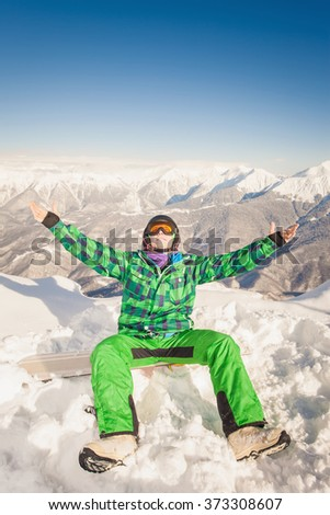 Image of happy male snowboarder or skier on the background of high snow capped mountain Alps, Swiss. Successful. Healthy lifestyle. Copy space - stock photo
