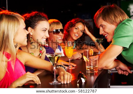 Image of happy teenagers chatting in the bar - stock photo