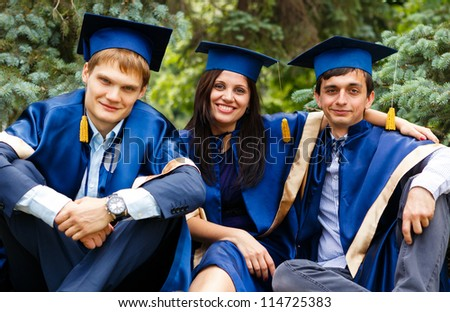 Image of happy young graduates - outdoor shot - stock photo