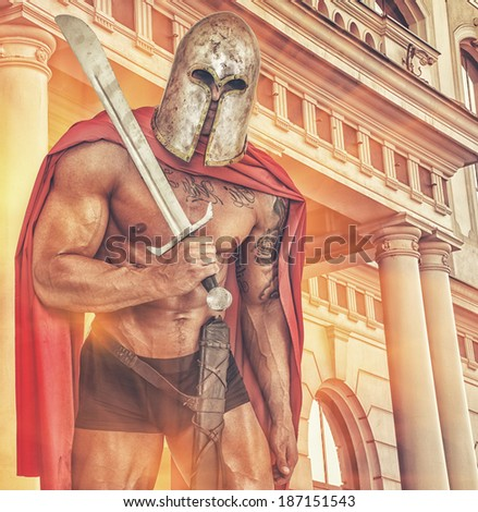 Image of huge half naked warrior near the old Rome building - stock photo
