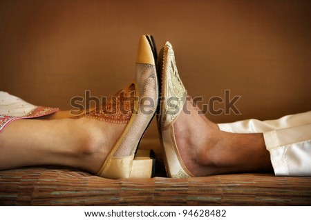 Image of Indian bride and groom's wedding shoes - stock photo