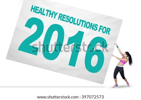 Image of Indian woman wearing sportswear pull a big board with a text of healthy resolutions for 2016 - stock photo