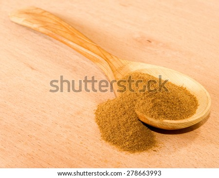 image of instant coffee in a wooden spoon - stock photo