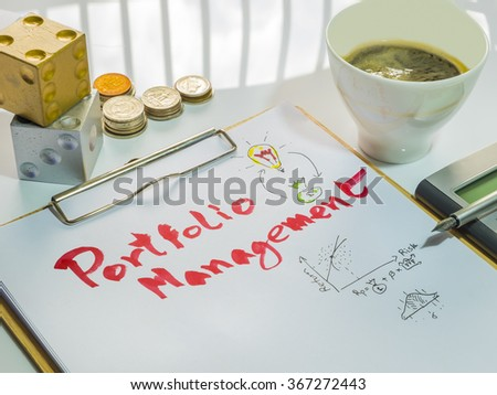 Image of Investment Management. Portfolio Management word on sheet with clipboard, cup of coffee, calculator, pen, coins and dices. - stock photo
