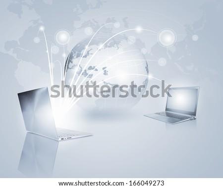 Image of laptop with globe illustration at background - stock photo