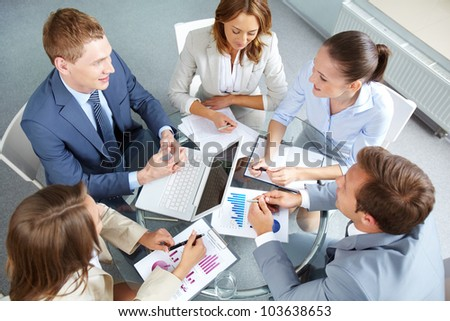 Image of large group of confident partners planning work at meeting - stock photo