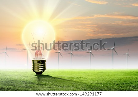 Image of light bulb against nature background. Ecological concept - stock photo