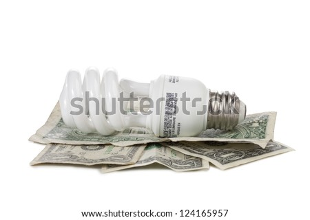 Image of light bulb and dollars with energy saving concept - stock photo