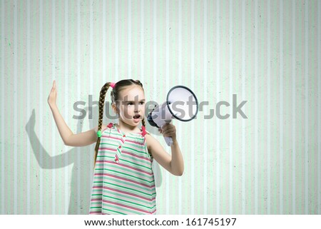 Image of little cute girl screaming angrily in megaphon - stock photo