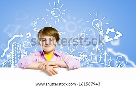 Image of little cute with blank banner against color background - stock photo