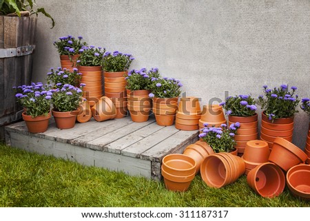 Image of lots of terracotta plant pots, at a garden center.  - stock photo