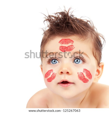 Image of lovely Cupid boy with red lipstick stamp on his cheeks and forehead isolated on white background, Valentines day, romantic holiday, beautiful blue eyes, love and care concept - stock photo