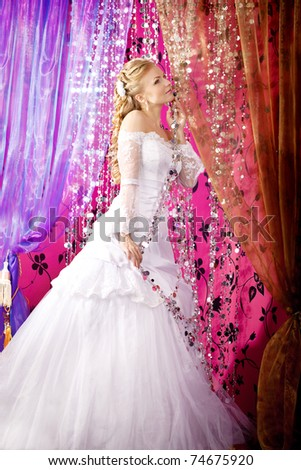 Image of luxe bride on a bright background - stock photo
