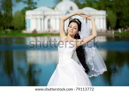 Image of luxury bride near palace - stock photo