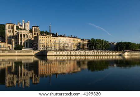 Image of Lyon, France, showing Notre Dame de Fourviere basilica and the bank of the Saone river - stock photo