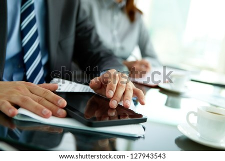 Image of male hands with digital tablet touching its screen - stock photo