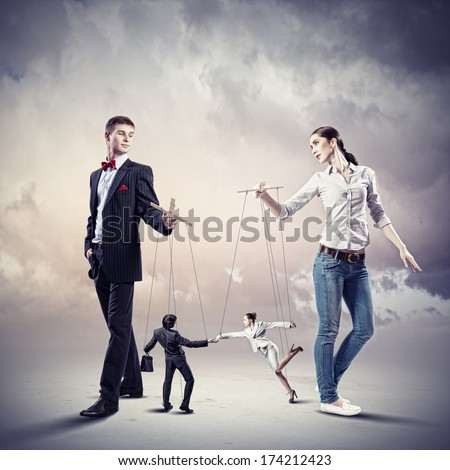 Image of man and woman with marionette puppets - stock photo