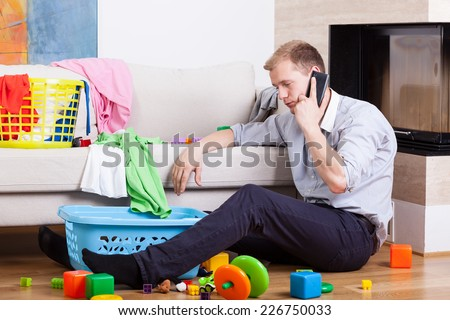 Image of man being alone at home with child - stock photo