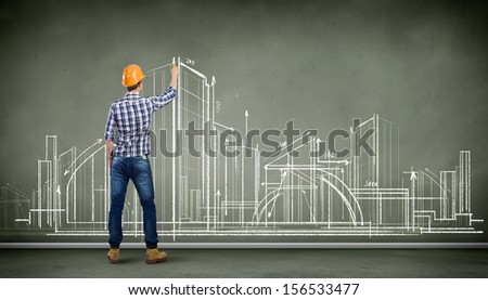 Image of man engineer against building project sketch - stock photo