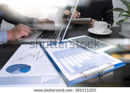 Image of man hand pointing at business document during discussion at meeting - stock photo