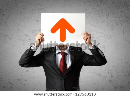 Image of man holding board with arrow picture - stock photo