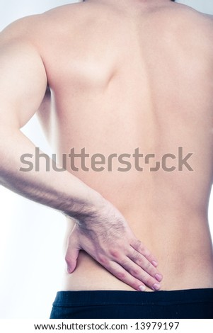 Image of man touching his diseased small of the back - stock photo