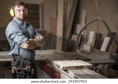 Image of mature carpenter in the workshop - stock photo