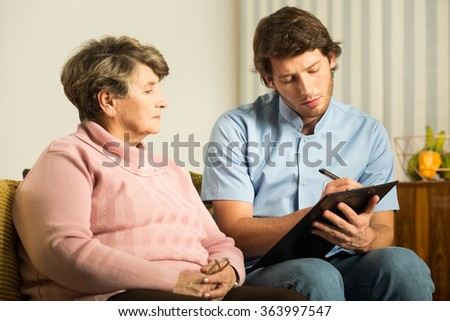 Image of medical interview with ill elderly female - stock photo