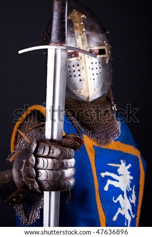 Image of mighty knight and his sword - stock photo