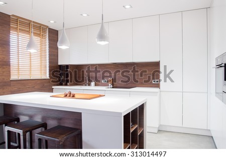 Image of modern design spacious light kitchen interior - stock photo