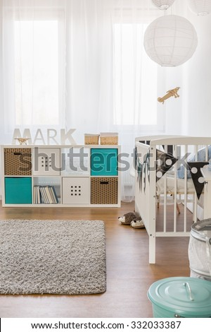 Image of modern infant room with new furniture - stock photo