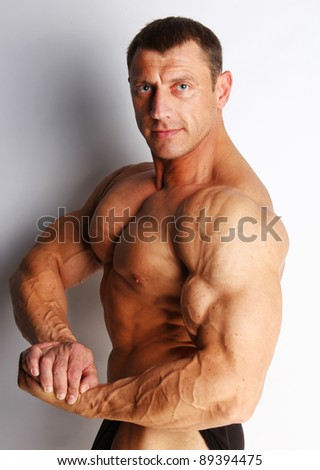Image of muscular bodybuilder posing - stock photo